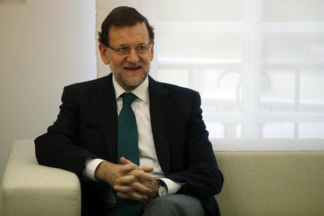 Spain's Prime Minister Mariano Rajoy smiles during a meeting with Saudi Arabia Transport Minister Jubara Al Suraisry (not pictured) at Madri