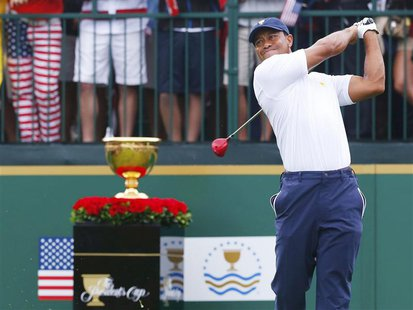U.S. golfer Tiger Woods tees off on the first hole against International team member Richard Sterne of South Africa during the Singles match