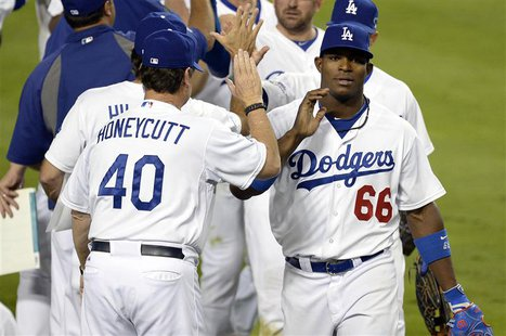 October 6, 2013; Los Angeles, CA, USA; Los Angeles Dodgers right fielder Yasiel Puig (66) celebrates the 13-6 victory against the Atlanta Br