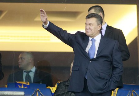 Ukrainian President Viktor Yanukovich waves before the 2014 World Cup qualifying soccer match between Ukraine and England at the Olympic sta