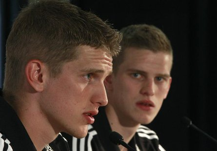 Germany's national soccer players and twins Sven (R) and Lars Bender listen during a news conference in Tourrettes, southern France, May 23,