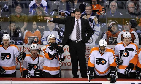 Philadelphia Flyers head coach Peter Laviolette instructs his team against the Winnipeg Jets during the third period of their NHL hockey gam