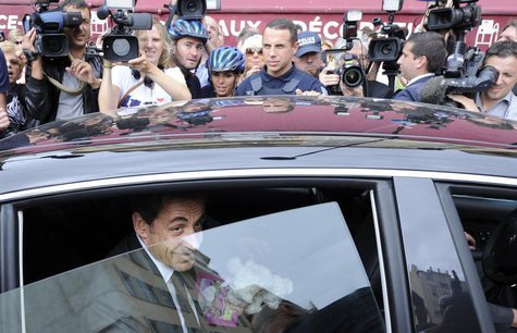 Former French president Nicolas Sarkozy leaves by car after a lunch with UMP political party members in Nice September 27, 2013. REUTERS/Oli