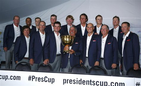 U.S. team captain Fred Couples holds the Presidents Cup during a team picture after the U.S. defeated the International team in the 2013 Pre