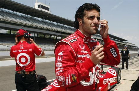 Target Chip Ganassi Racing driver Dario Franchitti of Scotland (R), prepares in pit lane during practice time at the Indianapolis Motor Spee
