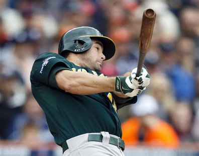 Oct 7, 2013; Detroit, MI, USA; Oakland Athletics designated hitter Seth Smith (15) hits a two-run home run in the fifth inning against the D