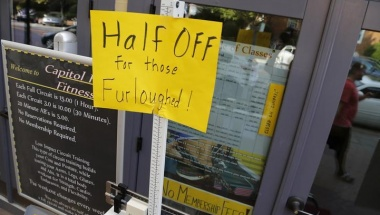 A sign at a fitness studio advertises a deal for furloughed government workers in the Capitol Hill neighborhood in Washington on October 5, 2013. REUTERS/Jonathan Ernst