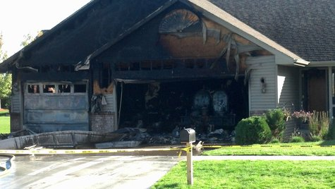 Six people are displaced after a garage fire in Appleton Monday afternoon. It happened around 2:30 at 4225 Ashbury Dr. (Photo by: FOX 11).