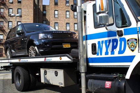 The SUV involved in Sunday's Manhattan's Henry Hudson Parkway motorcycle accident is seen on a NYPD truck arriving to the 33 precinct in New