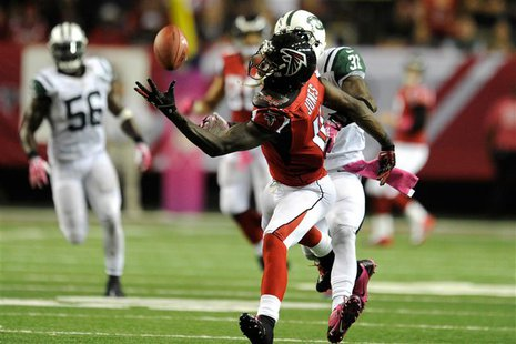 Oct 7, 2013; Atlanta, GA, USA; Atlanta Falcons wide receiver Julio Jones (11) makes a one handed catch behind New York Jets cornerback Anton