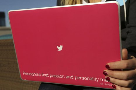 A Twitter logo is shown on a laptop computer at the company's headquarters in San Francisco, California October 4, 2013. REUTERS/Robert Galb