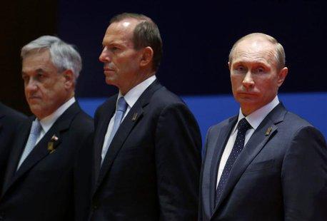 Chile's President Sebastian Pinera (L-R), Australia's Prime Minister Tony Abbott and Russia's President Vladimir Putin listen during the lea