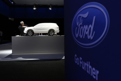 A Ford employee works on a model at a media event to launch a concept car in Sydney August 13, 2013. REUTERS/Daniel Munoz
