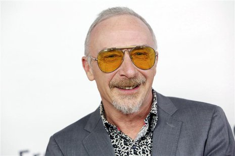 "Singer Graham Parker arrives at the premiere of the movie ""This is 40"" at Grauman's Chinese Theatre in Hollywood, California in this Decembe"
