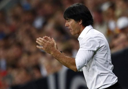 Germany's coach Joachim Loew gestures during their 2014 World Cup qualifying soccer match against Austria in Munich September 6, 2013. REUTE