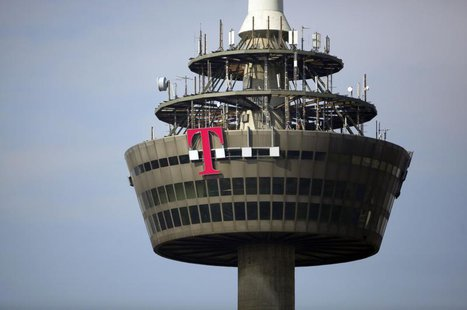 "The logo of Deutsche Telekom is pictured on the 266 metre high ""Colonia"" TV tower in the western German city of Cologne March 25, 2013. REUT"