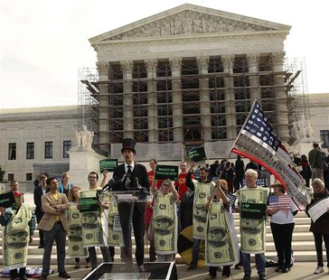 Protesters gather in front of the U.S. Supreme Court during a rally against large political donations in Washington October 8, 2013. REUTERS