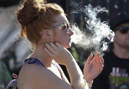 A woman smokes a joint at the High Times U.S. Cannabis Cup in Seattle, Washington September 8, 2013. REUTERS/Jason Redmond