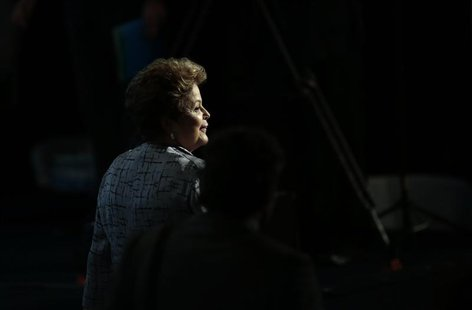 Brazil's President Dilma Rousseff leaves after attending the opening of the Third Global Conference on Child Labour in Brasilia October 8, 2