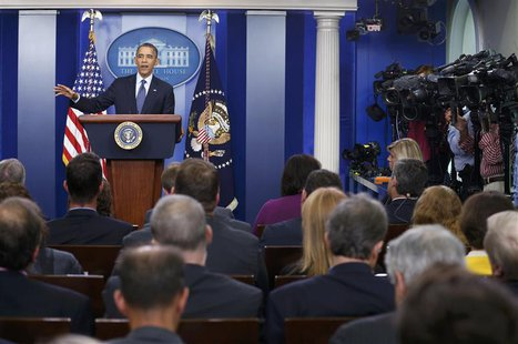 U.S. President Barack Obama speaks to reporters about the continuing government shutdown during a news conference from the White House Brief