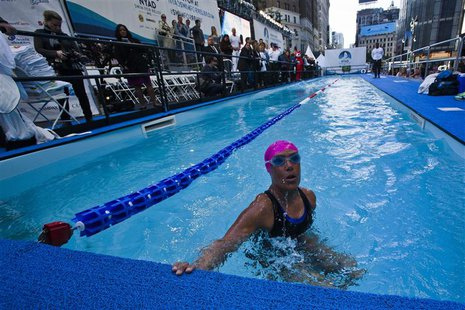 U.S. long-distance swimmer Diana Nyad takes a breath during her 48 hour continuous swim at Herald Square in New York October 8, 2013. REUTER