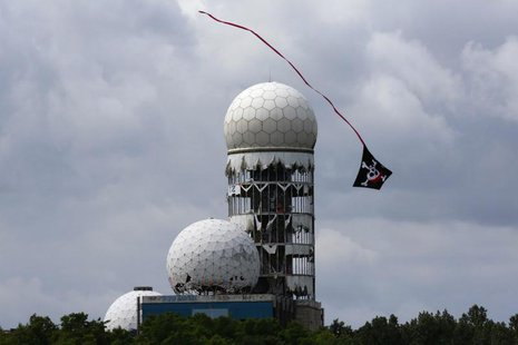 A kite flies near antennas of Former National Security Agency (NSA) listening station at the Teufelsberg hill (German for Devil's Mountain)