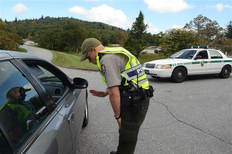 Park Ranger Joseph Darling directs visitors away from the entrance to the Pisgah Inn on the Blue Ridge Parkway southwest of Asheville, North