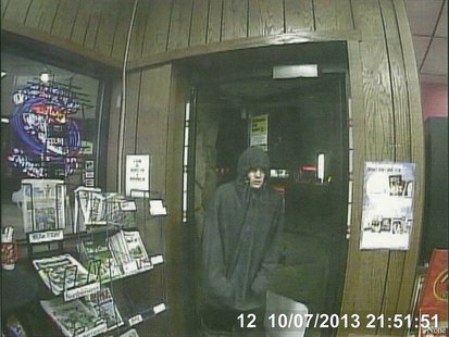 Surveillance photo of attempted robbery suspect at Lang Oil Gas Station in Oshkosh.