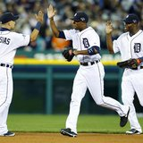 Oct 8, 2013; Detroit, MI, USA; Detroit Tigers players Jose Iglesias (1) , Austin Jackson (middle) and Torii Hunter (right) celebrate after g