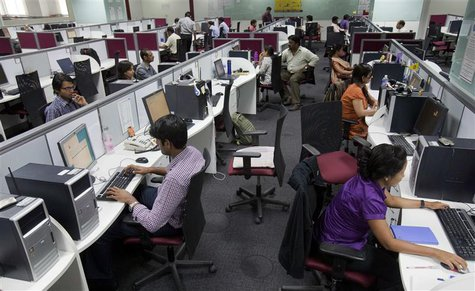 Employees are seen at their workstations on the floor of an outsourcing centre in Bangalore, in this file picture taken February 29, 2012. R