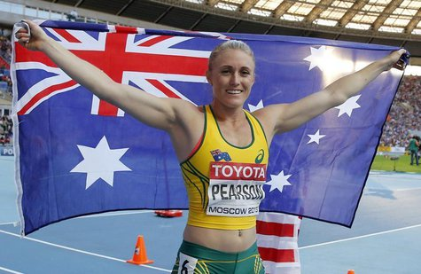Sally Pearson of Australia holds her national flag after finishing second in the women's 100 metres hurdles final during the IAAF World Athl