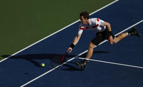 Andy Murray of Britain chases down a return to Stanislas Wawrinka of Switzerland at the U.S. Open tennis championships in New York September