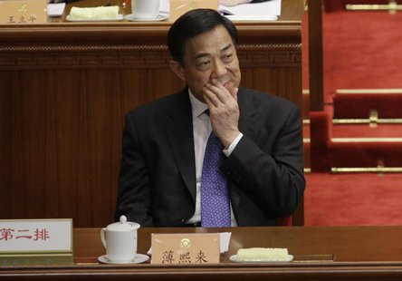 Former China's Chongqing Municipality Communist Party Secretary Bo Xilai reacts as he attends the opening ceremony of the Chinese People's P