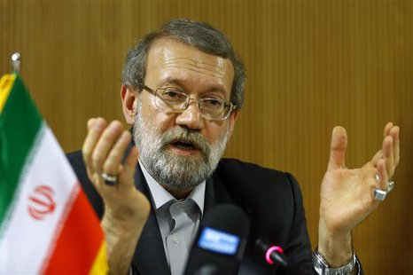 Ali Larijani, Speaker of the Iranian Parliament, gestures during a news conference after the 129th Assembly of the Inter-Parliamentary Union