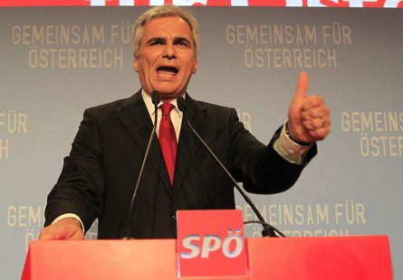 Austrian Chancellor and leader of the Social Democratic Party (SPOe) Werner Faymann addresses supporters after first projections in the Aust