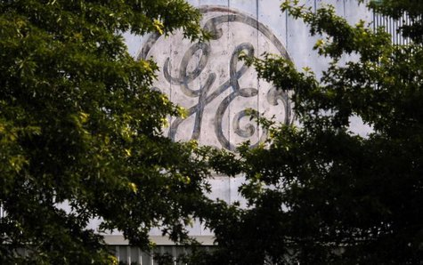 A faded, painted logo sits over the entrance to a General Electric Co. facility in Medford, Massachusetts in this July 17, 2009 file photo.
