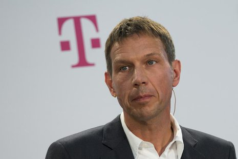 Deutsche Telekom CEO Rene Obermann attends a news conference to present a joint initiative for encrypted email with United Internet in Berli