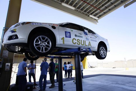 Student engineers from California State University Los Angeles stand by their eco-friendly re-engineered Chevrolet Malibu that was donated b