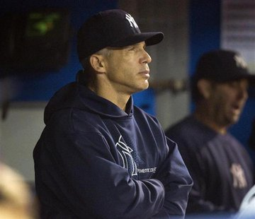 New York Yankees manager Joe Girardi watches from the dugout in the ninth inning of their American League MLB baseball game against the Toro