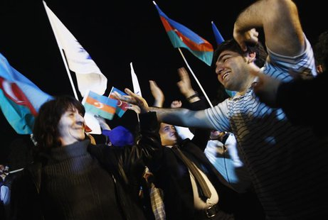 Supporters of Azerbaija's President Ilham Aliyev celebrate his victory on the presidential elections in Baku, October 9, 2013. REUTERS/David