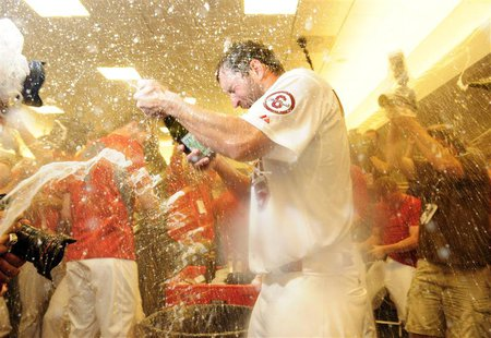 Oct 9, 2013; St. Louis, MO, USA; St. Louis Cardinals starting pitcher Adam Wainwright (50) celebrates with teammates after game five of the