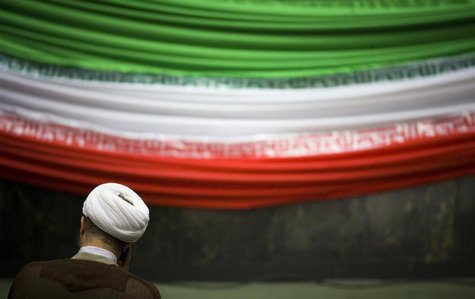 A lawmaker sits at the Iranian Parliament as he attends a ceremony to mark Parliament day in Tehran December 1, 2009. REUTERS/Morteza Nikoub