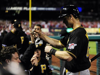 Oct 9, 2013; St. Louis, MO, USA; Pittsburgh Pirates first baseman Justin Morneau (66) celebrates scoring against the St. Louis Cardinals dur