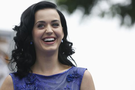 "Singer Katy Perry, who voices the character of ""Smurfette"", smiles at the premiere of ""The Smurfs 2"" at the Regency Village theatre in Los A"