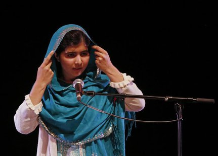 Pakistan's Malala Yousafzai adjusts her headscarf as she gives a speech after receiving the RAW (Reach All Women) in War Anna Politkovskaya
