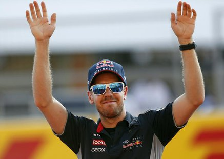 Red Bull Formula One driver Sebastian Vettel of Germany waves to fans at the Suzuka circuit October 10, 2013, ahead of Sunday's Japanese F1