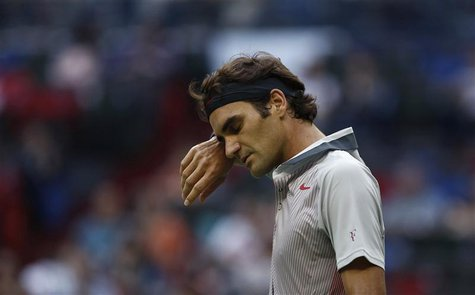 Roger Federer of Switzerland reacts after losing a point during his men's singles tennis match against Gael Monfils of France at the Shangha