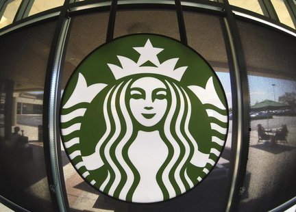 The Starbucks logo hangs on a window inside a newly designed Starbucks coffee shop in Fountain Valley, California August 22, 2013. REUTERS/M