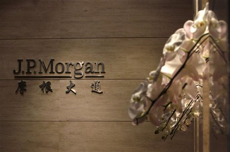 The JP Morgan sign is pictured at its Beijing office, in this picture taken December 13, 2010. REUTERS/Jason Lee