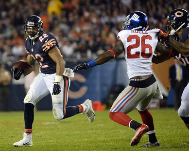 Oct 10, 2013; Chicago, IL, USA; Chicago Bears running back Matt Forte (22) rushes the ball against New York Giants strong safety Antrel Roll
